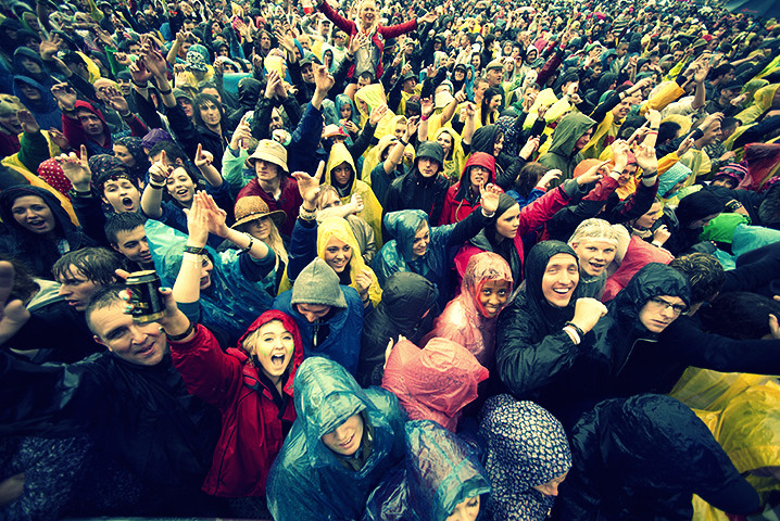 Festival Goers endure the rain at  main stage during T In The Park Festival