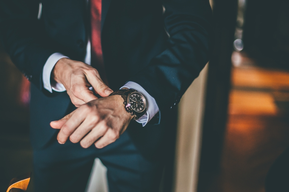 Well Dressed Man putting his wrist watch