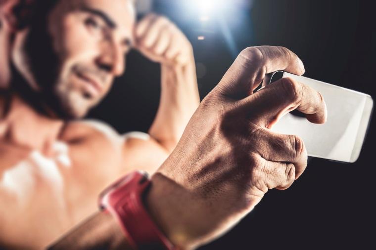 Muscular Man taking a selfie