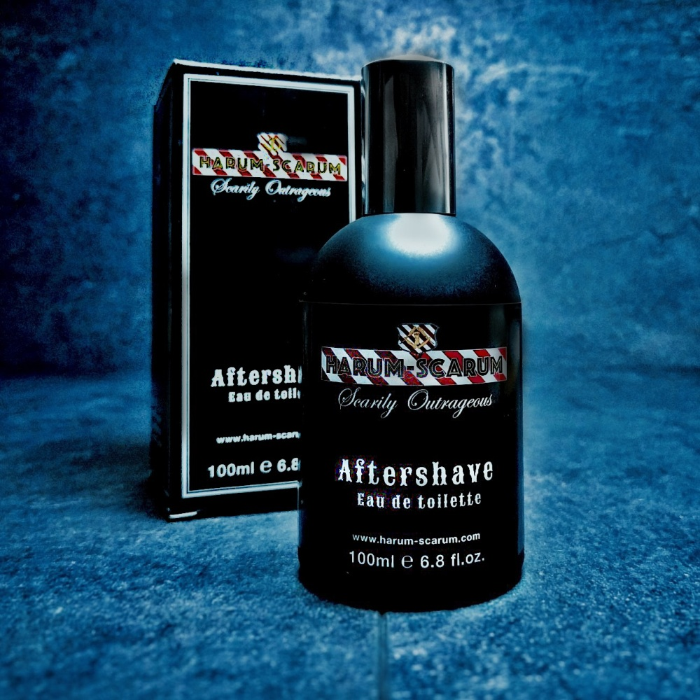 Black bottle of Men's Aftershave in front of Box