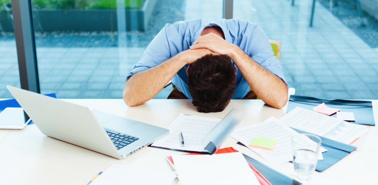 Man frustrated at work ready for a holiday