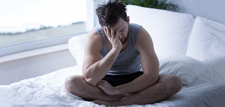 Sleepy man tired in bed