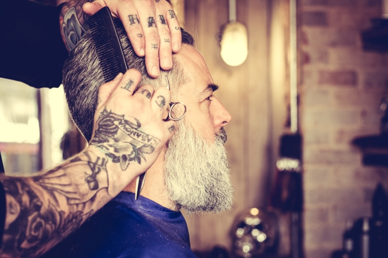 Man having hair styled at the barbers