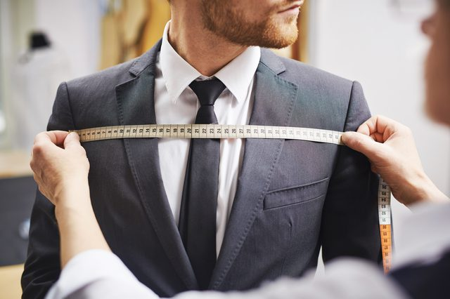 Suit, Man being measured for a suit, tailoring, tailored suit, tape measure, suits and tuxedo, smart and suits, tie, blazer