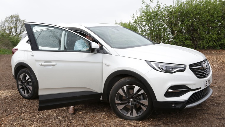 Man getting in a 4x4, Vauxhall Grandland X, White Jeep, New Car, Car in Field